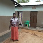 MIDI ROSE UMOJA VSLA (2) INFRONT OF HER HOUSE.